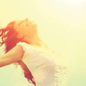 joyfull woman with arms wide open